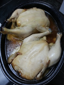 Roasted chicken chilling in it's own juices.