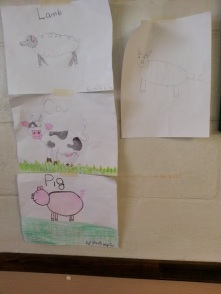 My daughter's drawings proudly displayed on their wall!