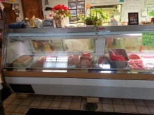 Meat case slowly getting filled with fresh meats....
