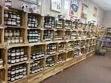 Wall of homemade jams, preserves, butters, etc...