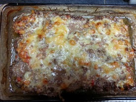 Edges pulled away from the sides of the baking dish and the cheese is beautifully melted. Finished meatloaf.