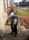 Piggy back ride. The youngest has in Vampire fangs in December....