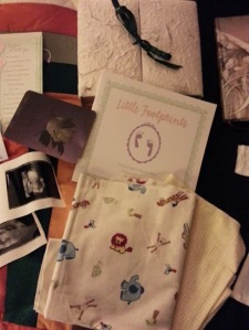 His keepsake box, his baby blankets that I used to design his nursery, hand and foot prints in the book...