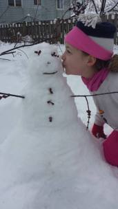 Kissing the snowman.