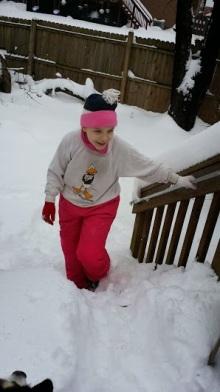 Middle deciding to brave the steps to go play in the backyard.