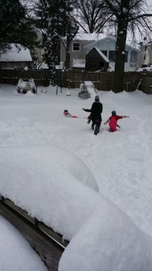 All 3 kids in the snow.