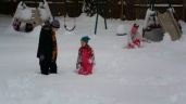 They got the 4 yr old standing upright. The snow is up to her crotch.