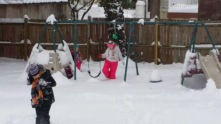 The middle decided to play on the swingset.