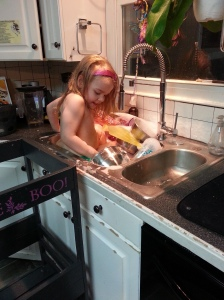 Sink Before. My youngest decided to first wash the dishes. Then decided to jump into the sink and wash them that way....
