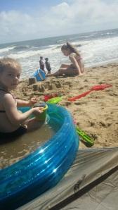 Reine is enjoying her pool. Cy building sand castles.