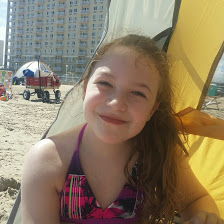 Cy LOVING the beach....